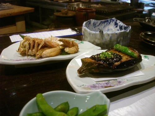 Crab legs, eggplant, edamame. Check.